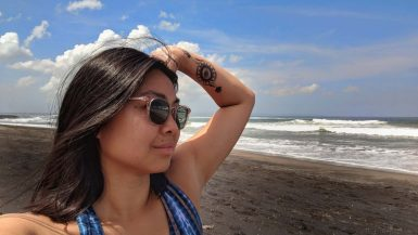 Showing tattoo on Batu Bolong Beach, Bali, Indonesia